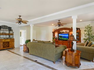 Princeville house photo - Family Room with large entertainment center and 50' TV