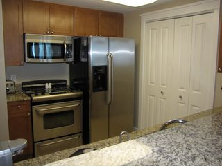 Fort Walton Beach condo photo - Kitchen with granite, range, microwave, refrigerator, and dishwasher.