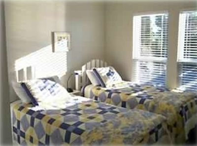 Guest bedrooms have ceiling fans, large closets, and TV.