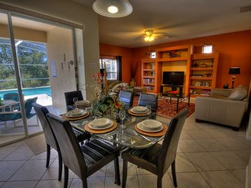 The casual dining area overlooks the pool