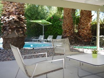 A view from the covered patio adjacent to the pool area