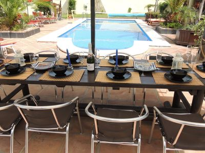 Al Fresco Dining at it's very best with custom made table, Gas BBQ & Pool View