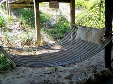 Relax in the hammock under the house