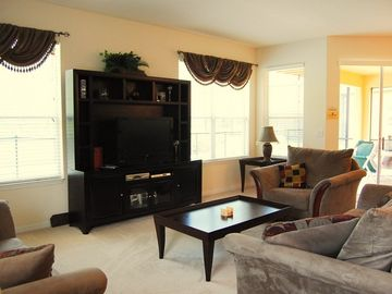 Spacious lounge with plasma screen TV and DVD