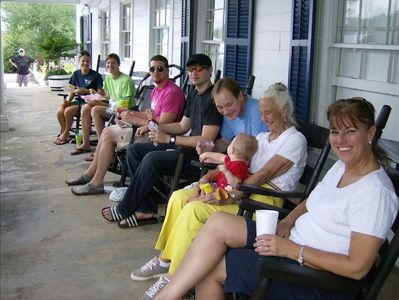 Folks relaxing on the famous front-porch rocking chairs