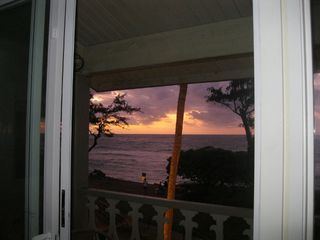 Kapaa condo photo - Sunrise standing inside looking through slider.