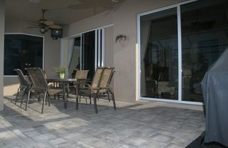 Marco Island house photo - Large lanai with table for six, two chaise lounges and grille.
