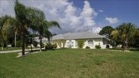 Beautiful Canal View Home with Large Lanai, Pool, Spa, Bikes
