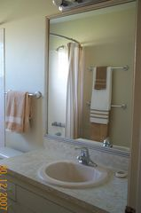 Vero Beach house photo - Hall bath with tiled tub/shower combo, shower wand, safety bars, tile floor.