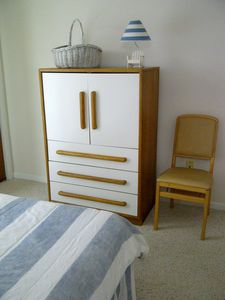 Cabinet houses TV and storage drawers