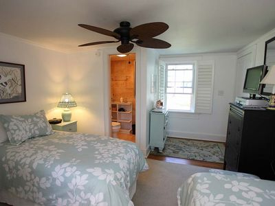 The Blue Heron has two twin beds and half bath in room and full bathroom.