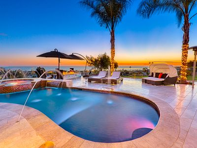 Custom pool, hot tub and spacious terrace with sunset views await you at Visions of Paradise