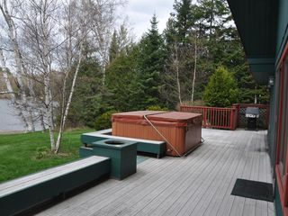 Lake Placid house photo - Hot tub on back deck with lake views.