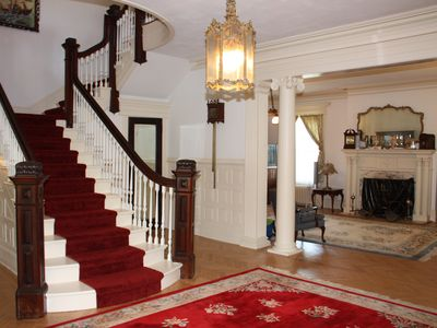South Jamesport chateau / country house rental - The staircase with a view of the living room.