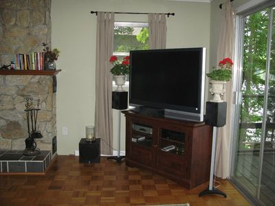 Upper level 50' HD TV. Satellite service with HD channels & DVR included.