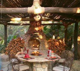 Ojai estate photo - Tiki house massive outdoor dining fireplace with tons of wood to burn