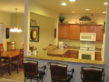 Well appointed kitchen and dining room with seating for 8, plus bar