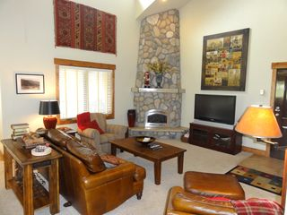 Steamboat Springs condo photo - Living Room with Large Rock Fireplace