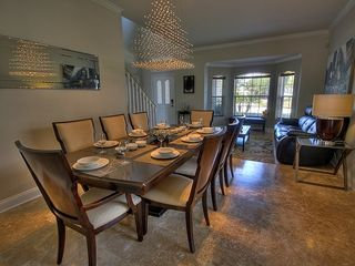 Champions Gate villa photo - Dining room with ample seating, opens to Living room, spacious entertaining area