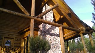 Whitefish cabin photo - Beautiful stone work/hand sewn logs inside and outside highlight the property
