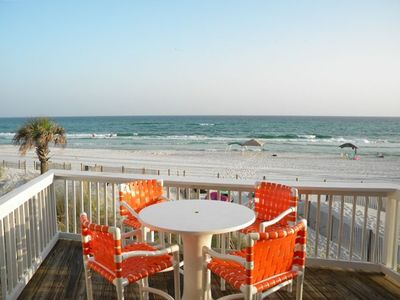 Walk off your private deck into white sands of the Gulf.