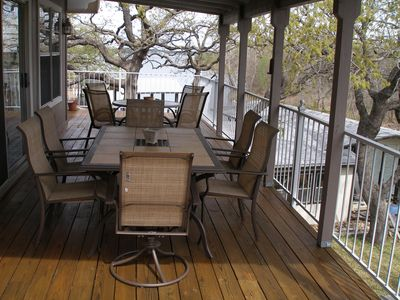 Covered deck with seating for 10 and great water and preservation land views..