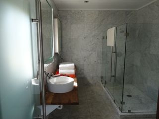 Governor's Harbour villa photo - Downstairs all marble ensuite master bathroom with all designer fixtures