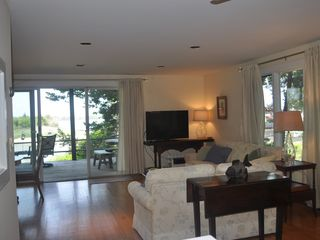 East Quogue house photo - View of living area and back porch.