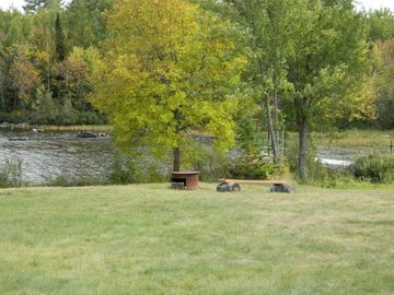 Property has plenty of yard space for activities and fire pit near the shoreline