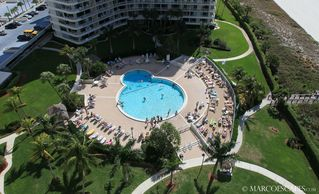 Vacation Homes in Marco Island condo photo - Large Heated Community Pool on the Beach ...