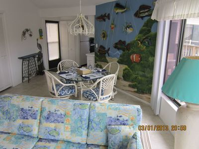 Dining & Front entry with view of beautiful ocean mural painted by local artist.