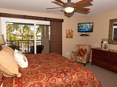 Waikoloa Beach Resort townhome rental - Master bedroom has an outside lanai with tropical views to the pool & waterfall