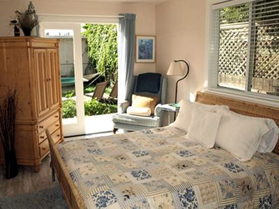 Queen bed with TV/DVD player, french doors open to garden, hammock and hot tub