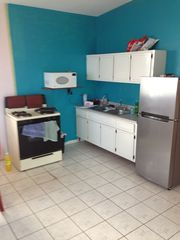 Isabela house photo - Upstairs kitchen. Gas range, microwave, frig, coffee maker, sink, dishes etc