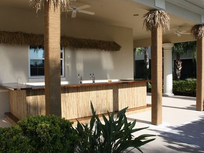 Tiki bar. Grab a drink and relax by the pool.