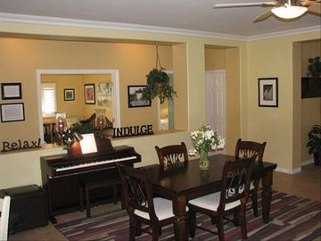 Open floor plan with extra dining room table and piano!