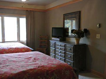 Guest room w/ 2 queen beds, 2 closets and private remodeled bath.