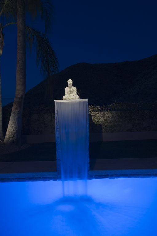 The pool fountain at night.