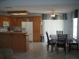 South Padre Island house photo - Main kitchen & dining area view from living room.