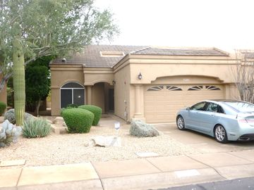 Other Scottsdale Properties townhome rental - 1496 sq ft and large garage for car, clubs and bikes.