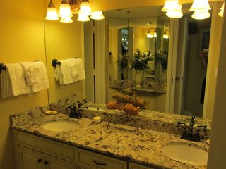 Master bath with new graite counters, cabinets, and upscale fixtures. - Destin condo vacation rental photo