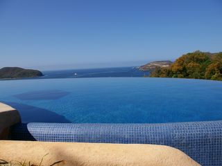 Zihuatanejo condo photo - Spectacular view from large shared Infinity Pool
