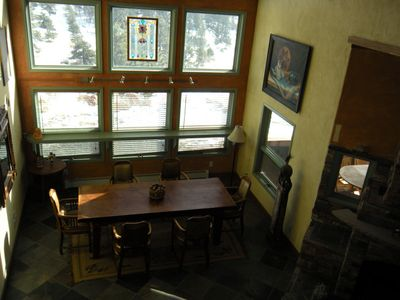 Sunny dining room - 20 feet of floor to ceiling windows with views of mountains