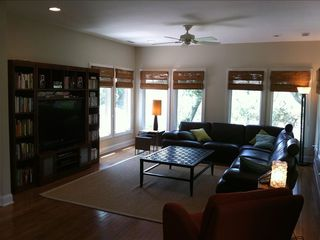 Bald Head Island house photo - Living room with easy chair, 50 inch TV, library, and Natuzzi leather sectional