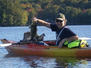 Milan cabin photo - Bruce with a nice fish at Lake Umbagob in Errol on Columbus Day weekend