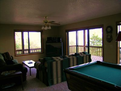 Family Room with Huge TV with Satellite reception. Pool Table for fun!