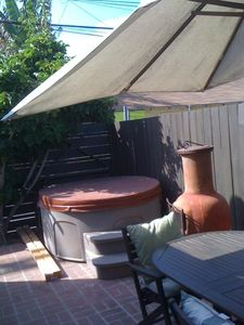 4-person jacuzzi on the brick patio