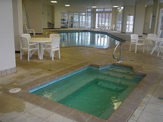 Osage Beach condo photo - Indoor hot tub, indoor pool, workout room, sauna
