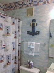 Lighthouse theme bath off master bedroom. - Myrtle Beach Resort condo vacation rental photo