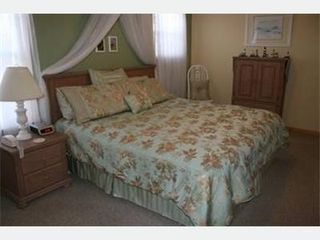Duck house photo - Enjoy a restful night sleep in this charming bedroom